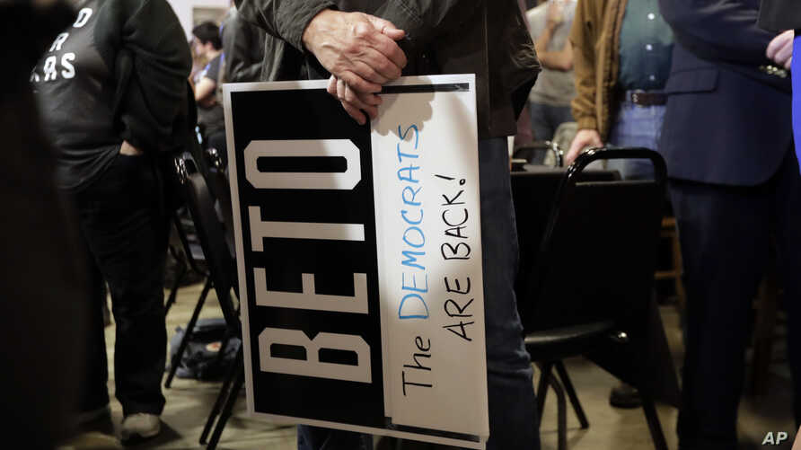 A supporter of senate hopeful Beto O'Rourke holds a sign during a Democratic watch party following the Texas primary election, Tuesday, March 6, 2018, in Austin, Texas.