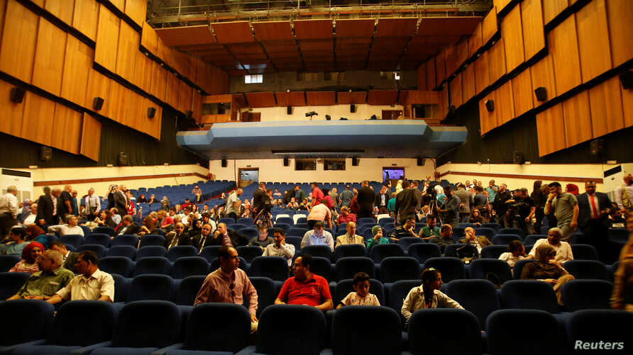 People watch 'Letters from Baghdad,' a documentary about Gertrude Bell, for the first time in Iraq at the National Theater of Baghdad, Iraq April 2, 2018. Picture taken April 2, 2018.