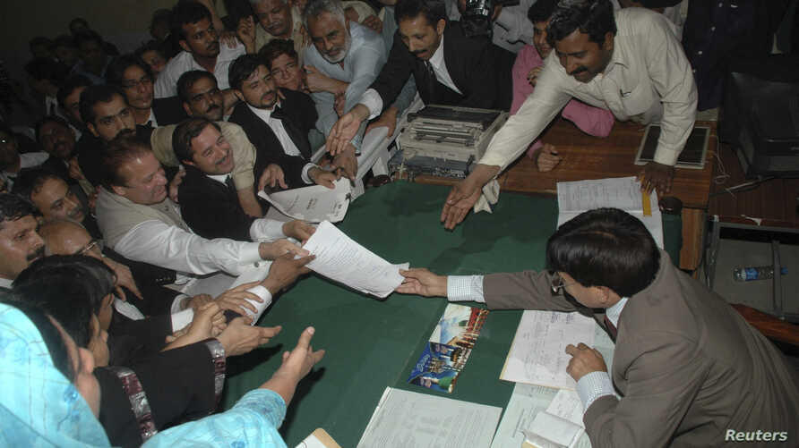 Pakistan's former prime minister Nawaz Sharif (C) submits his nomination papers for the upcoming by-elections in Lahore May 13, 2008. Pakistani prime minister Yousuf Raza Gilani called for a last-ditch effort to save his government on Tuesday, after