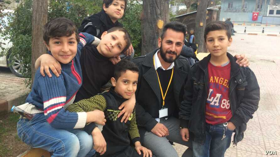 Boys in Reyhanli, Turkey pose for a picture, saying they are often afraid of rockets hitting their homes in Turkey, after they fled Syria for safety on Feb. 4, 2018.