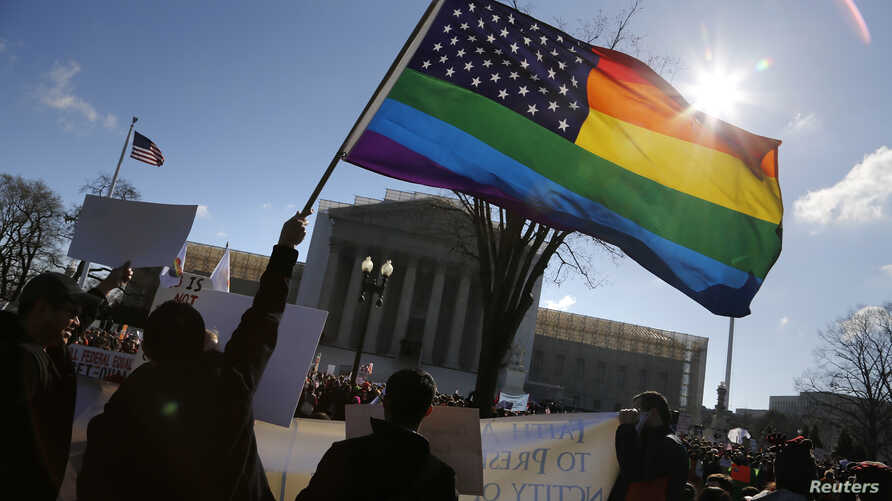 FILE - Gay activists wave a rainbow flag in front of the U.S. Supreme Court in Washington.