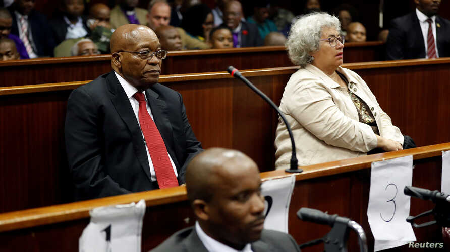 Former South African president Jacob Zuma, left, and accused company Thales, represented by Christine Guerrier, right, appear at the KwaZulu-Natal High Court in Durban, South Africa, April 6, 2018.