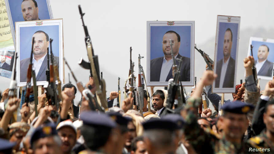 Houthi supporters hold posters of Saleh al-Samad, a senior Houthi official, during a funeral procession held for him and his six bodyguards, killed by Saudi-led airstrikes last week, in Sanaa, Yemen, April 28, 2018.