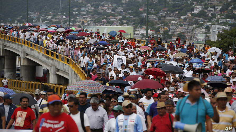 Demonstrators protest the disappearance of 43 students from the Isidro Burgos rural teachers college in Acapulco, Guerrero state, Mexico, Oct. 17, 2014.