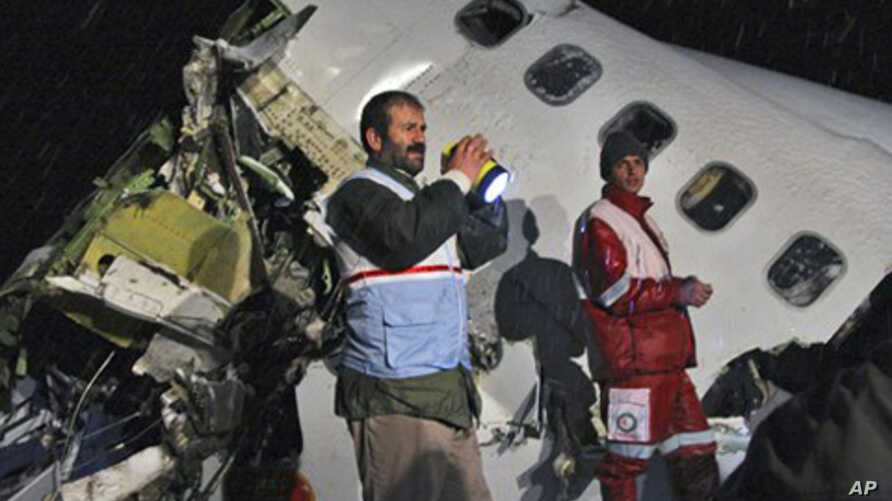 In this picture released by the Mehr news agency, rescue workers attend the scene after an IranAir passenger plane crashed as it was making an emergency landing, outside the city of Orumiyeh, Iran, Sunday, Jan. 9, 2011.