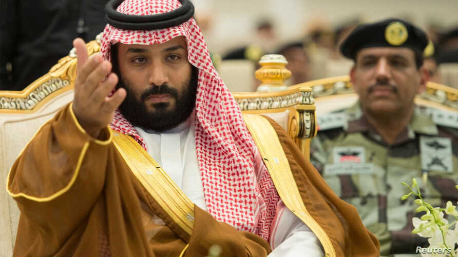 Saudi Crown Prince Mohammed bin Salman gestures during a military parade by Saudi security forces in preparation for the annual Haj pilgrimage in the holy city of Mecca, Saudi Arabia, Aug. 23, 2017.