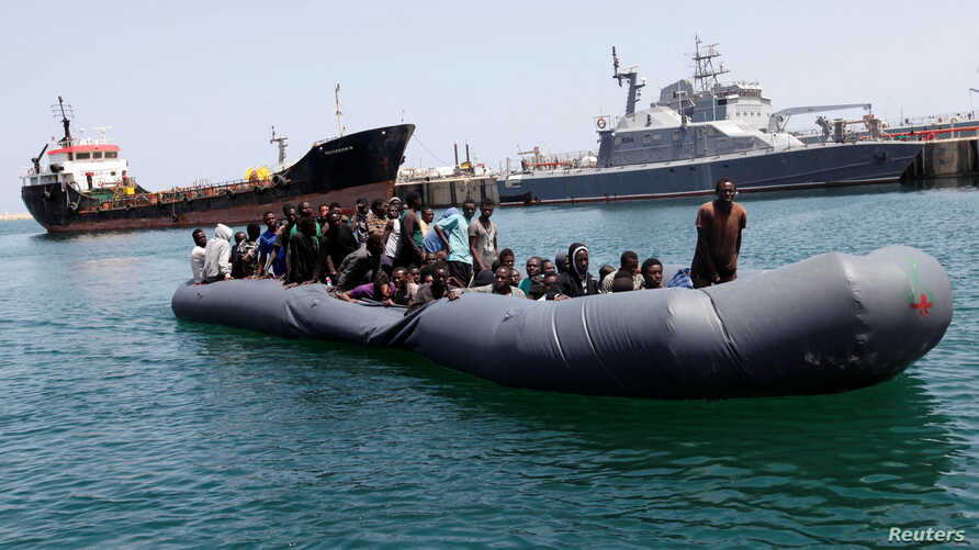 Illegal migrants arrive in a dinghy at a naval base after they were rescued by Libyan coastguard in the coastal city of Tripoli, Libya, May 6, 2017.