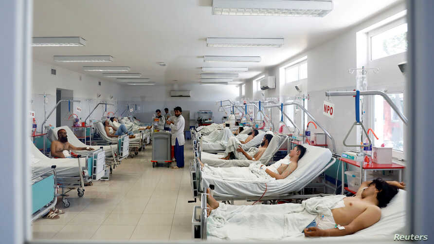 Afghan men who were injured in a recent attack in Kabul and Ghazni province, receive treatment at a hospital in Kabul, Afghanistan Aug. 18, 2018.