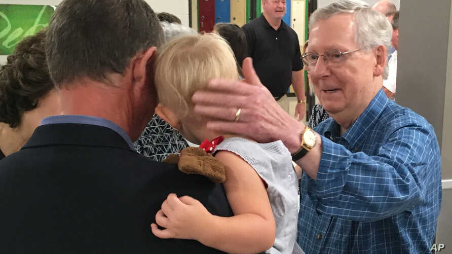 Senate Majority Leader Mitch McConnell greets constituents at the Graves County Republican Breakfast in Mayfield, Ky., Aug. 5, 2017. McConnell told Republicans not to be disheartened by the Senate's failure to repeal and replace former President Bara