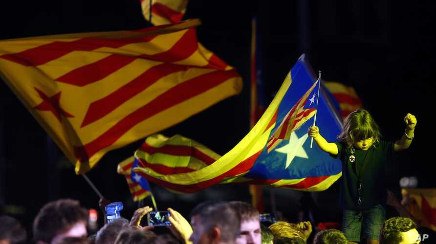 Catalonian pro-independence supporters celebrate in Barcelona, Spain, Sunday Sept. 27, 2015.