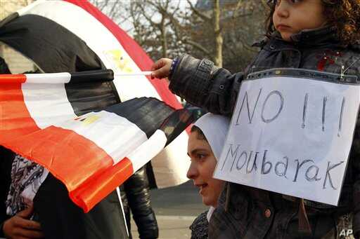 Demonstrators gather during a protest against Egyptian President Hosni Mubarak outside the Egyptian embassy in Paris, January 31, 2011