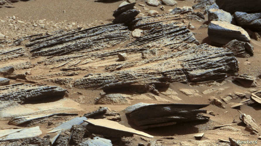 FILE - An image from NASA's Mars rover Curiosity shows the surface of the planet in this NASA handout released January 15, 2013.