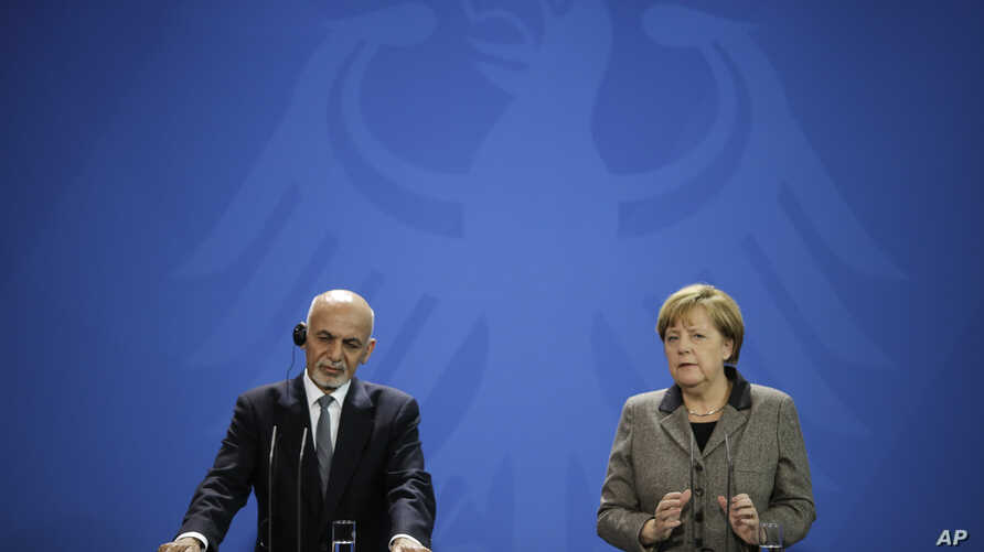 German Chancellor Angela Merkel, right, and the President  of Afghanistan, Ashraf Ghani brief the media after a meeting at the chancellery in Berlin, Dec. 2, 2015.