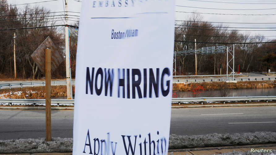FILE - A sign advertises open jobs at an Embassy Suites hotel in Waltham, Massachusetts, Dec. 13, 2017.