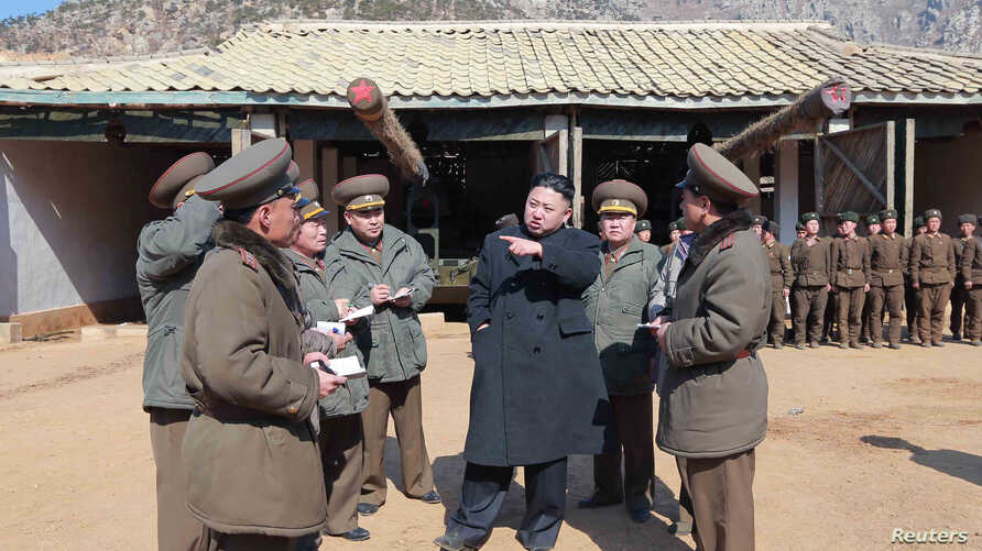 North Korean leader Kim Jong-Un (C) visits a long-range artillery sub-unit of the Korean People's Army Unit 641, March 11, 2013 in this picture released by the North's official KCNA news agency in Pyongyang, March 12, 2013.