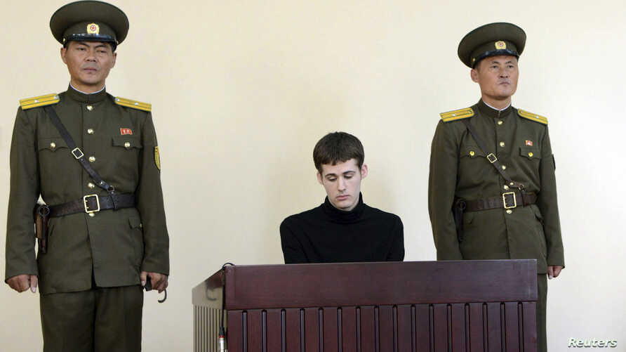 U.S. citizen Matthew Todd Miller sits in a witness box during his trial at the North Korean Supreme Court in this undated photo released by North Korea's Korean Central News Agency (KCNA) in Pyongyang September 14, 2014. North Korea sentenced Todd Mi...