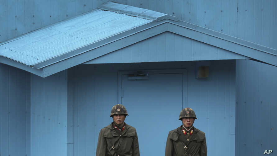 FILE - North Korean soldiers guard the truce village of Panmunjom at the Demilitarized Zone (DMZ) which separates the two Koreas.