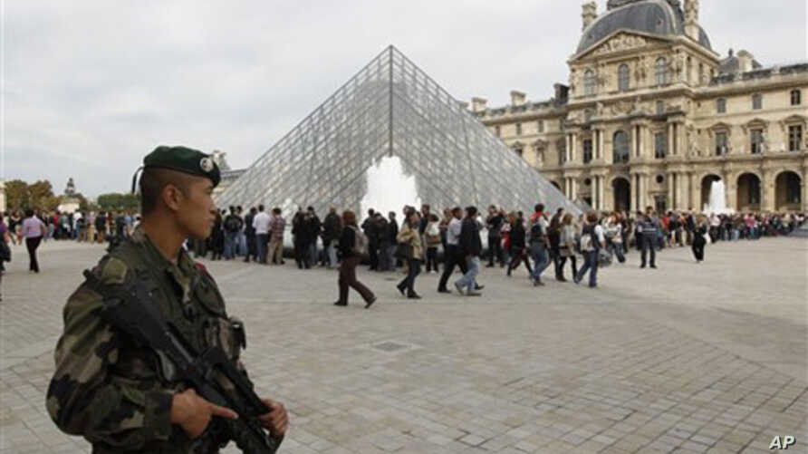 French soldiers patrol around the Louvre museum in Paris, Sunday, Oct. 3, 2010. The State Department has cautioned Americans traveling in Europe to be vigilant because of heightened concerns about a potential al-Qaida terrorist attack aimed at U.S. c