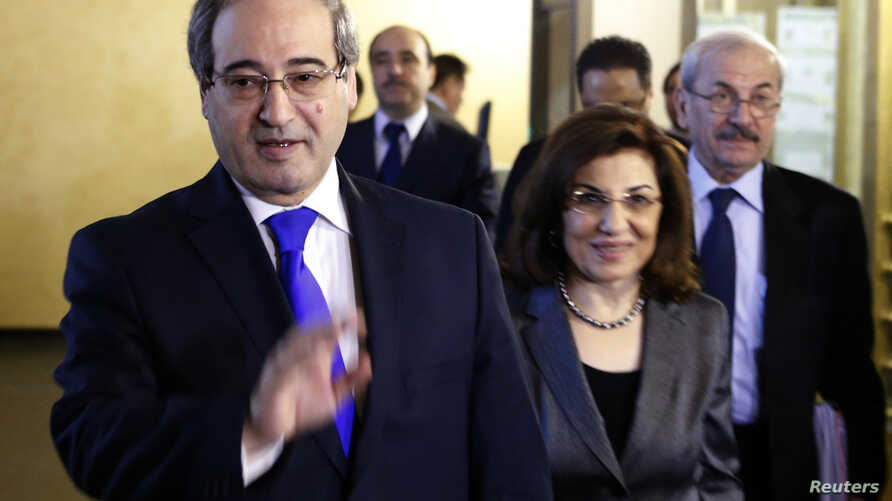 Syria's Deputy Foreign Minister Faisal Mekdad (L) leaves the headquarters of the Russian foreign ministry in Moscow, Nov. 18, 2013.