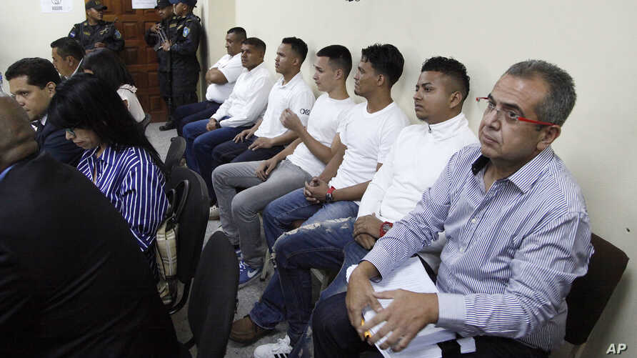 Men accused in the killing prize-winning Honduran indigenous and environmental rights activist Berta Caceres sit in a court room in Tegucigalpa, Honduras, Sept. 17, 2018.