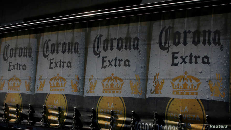 The logo of Corona beer, produced by a Group Modelo brewery in Mexico, is seen on a truck carrying bottles of beer in Mexico City, Jan. 27, 2017