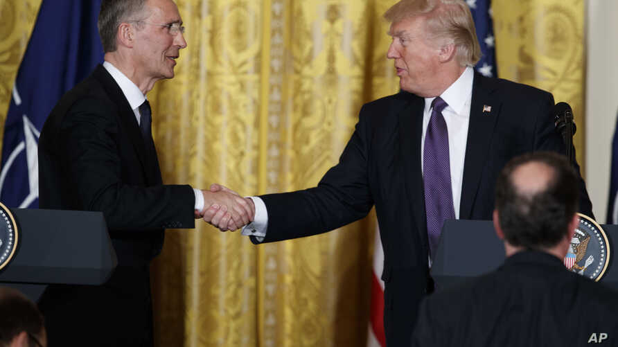 President Donald Trump shakes hands with NATO Secretary General Jens Stoltenberg during a news conference in the East Room of the White House, April 12, 2017, in Washington.