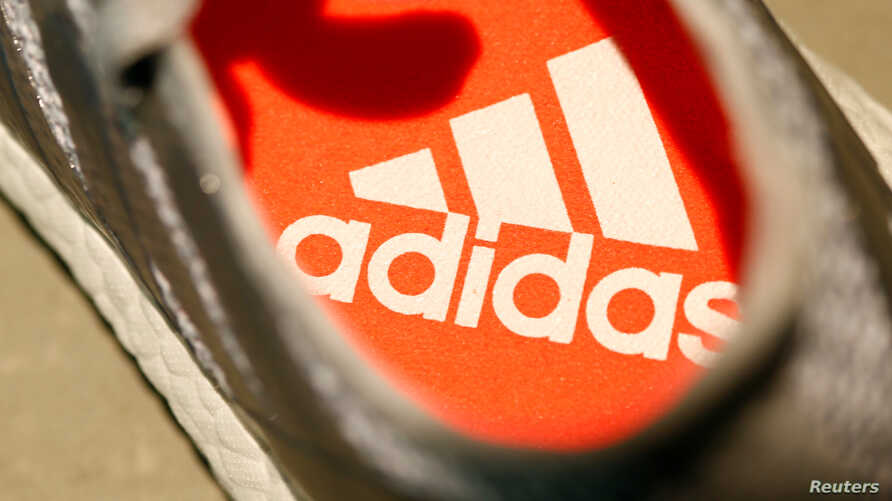 An Adidas logo is pictured inside a shoe before the company annual general meeting in Fuerth near Nuremberg, Germany, May 11, 2017.