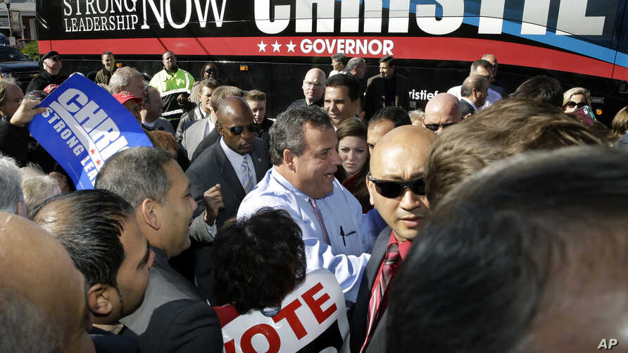 New Jersey Gov. Chris Christie, center, greets supporters during a campaign stop in Hillside, Nov. 4, 2013. Christie will face Democratic candidate, Barbara Buono in the election on Tuesday.