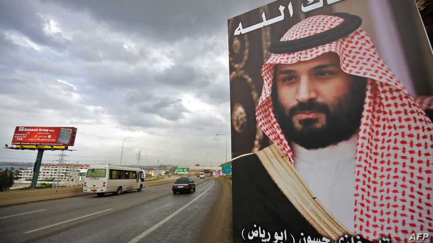 "FILE - A poster of Saudi Arabia's Crown Prince Mohammed bin Salman with a phrase reading in Arabic, "" God protect you"" is seen on a highway in the northern Lebanese port city of Tripoli, Nov. 9, 2017."