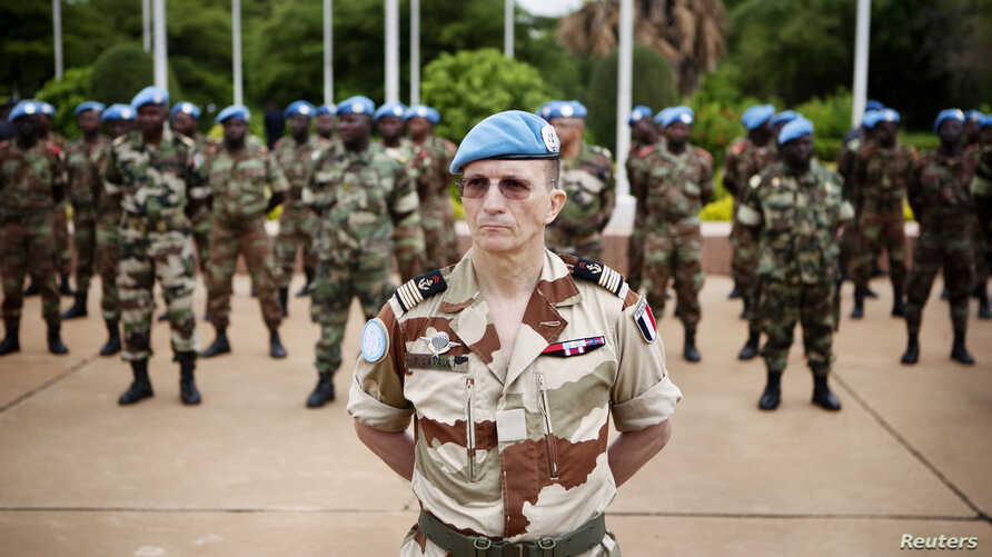 UN peacekeepers mark the start of the 12,000-strong U.N. peacekeeping mission (MINUSMA) in Mali, in Bamako July 1, 2013. REUTERS/Malin Palm (MALI - Tags: POLITICS) - RTX118KJ
