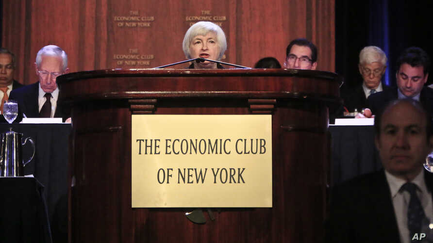 Federal Reserve Chairwoman Janet Yellen, center, speaks during a luncheon at the Economic Club of New York on Wednesday, April 16, 2014.