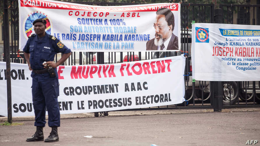 Banners in support of President of the Democratic Republic of Congo, Joseph Kabila are seen outside parliament, where the president holds his state-of-the-nation speech, in Kinshasa on July 19, 2018.