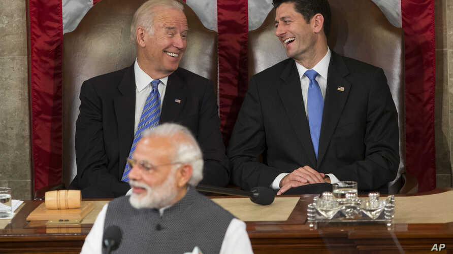 Vice President Joe Biden and House Speaker Paul Ryan of Wis., laugh as Indian Prime Minister Narendra Modi addresses a joint meeting of Congress on Capitol Hill in Washington, June 8, 2016.