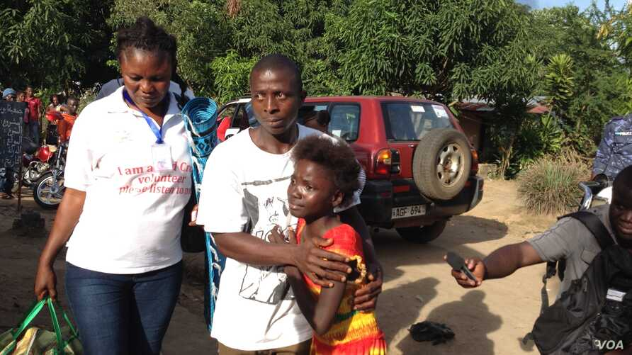 Kadiatu Bangura embraces her brother Emmanuel after being discharged from the Ebola Red Cross Treatment Center, Lumpa community, near Freetown, Sierra Leone, Sept. 27, 2014.