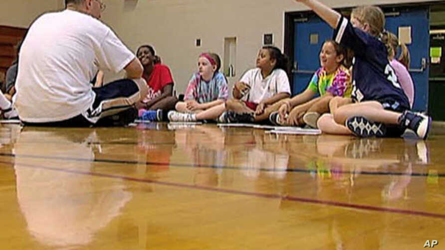Coach Andy Stadnik of the Amateur Athletic Union and his basketball team talk about the importance of ethics in sports and life, Oct 2010