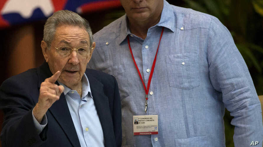 Cuba's President Raul Castro, left, gestures as he stands with Vice President Miguel Diaz Canel during the 7th Cuban Communist Party Congress in Havana, Cuba, April 16, 2016.