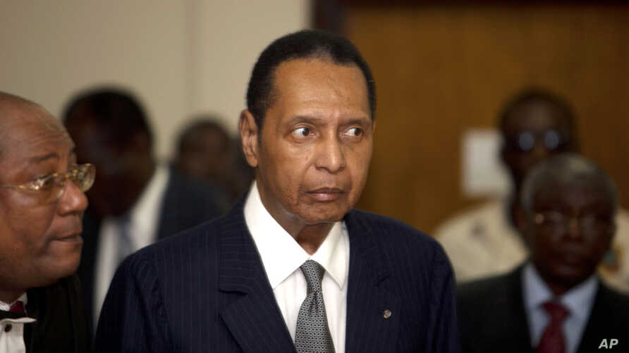 FILE - Former Haitian dictator Jean-Claude Duvalier attends his hearing at court in Port-au-Prince as authorities charged Duvalier with human rights abuses and embezzlement.