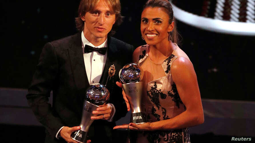 Brazil's Marta, left, who received the Best FIFA Women's player award and Croatia's Luka Modric who received the Best FIFA Men's Player award, pose during the ceremony of the Best FIFA Football Awards in the Royal Festival Hall in London, Britain, Mo
