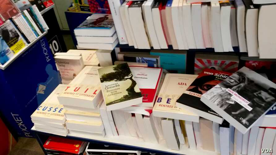 A selection of this fall's novels is stacked at L'Alba bookstore in the French town of Ile Rousse. (L. Bryant/VOA)