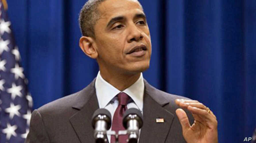 President Barack Obama gestures during a statement on the US-Korea Free Trade Agreement in Washington, 04 Dec. 2010