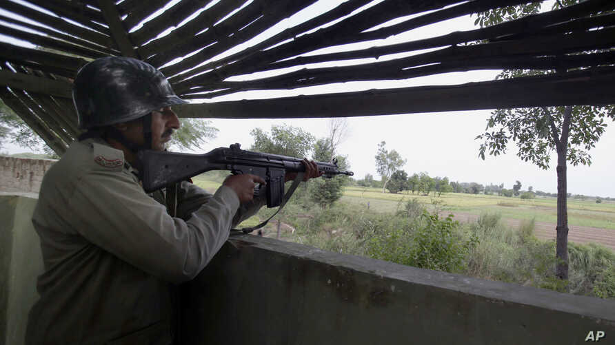 A Pakistani paramilitary soldier is seen inside a bunker monitoring an area on the border of Pakistan and India in Dhamala Hakimwala, Pakistan, Oct. 8, 2014.