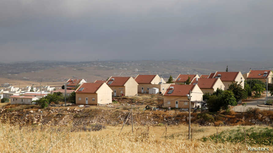 FILE - Houses are seen in the West Bank Jewish settlement of Karmel, near Hebron, May 24, 2016.