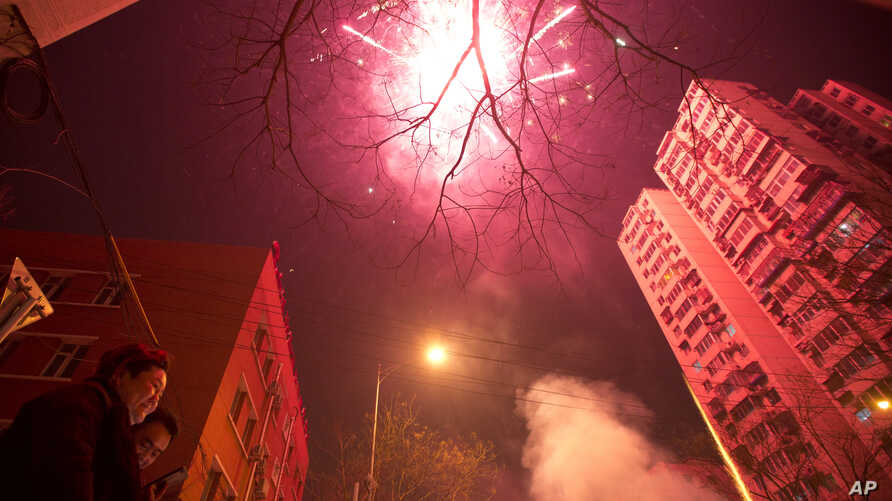 Residents set off fireworks on the eve of Lunar New Year in Beijing, China, Friday, Jan. 27, 2017. Chinese worldwide celebrate the Year of the Rooster on Jan 28, 2017, with family reunions and fireworks.