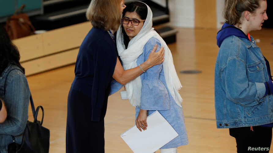 Malala Yousefzai is congratulated after collecting her 'A' level exam results at Edgbaston High School for Girls in Birmingham, Britain, Aug. 17, 2017.