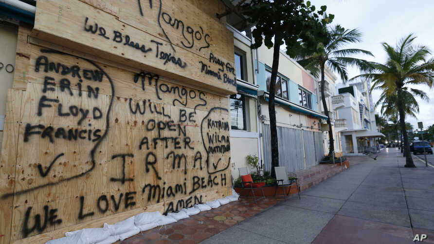A boarded up building on normally bustling South Beach is seen, Sept. 8, 2017 in Miami Beach, Florida. The first hurricane warnings were issued for parts of southern Florida as the state braced for what could be a catastrophic hit over the weekend.
