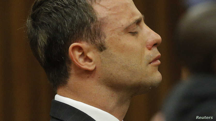 Olympic and Paralympic track star Oscar Pistorius reacts as he listens to Judge Thokozile Masipa's judgement at the North Gauteng High Court in Pretoria, September 11, 2014. A South African judge cleared Oscar Pistorius of all murder charges on Thurs