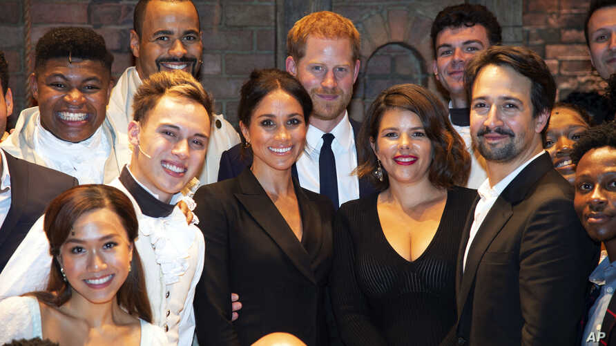 Britain's Prince Harry and Meghan, Duchess of Sussex meet the cast after a gala performance of the musical Hamilton, in support of the charity Sentebale, at the Victoria Palace Theatre in London, Aug. 29 2018.