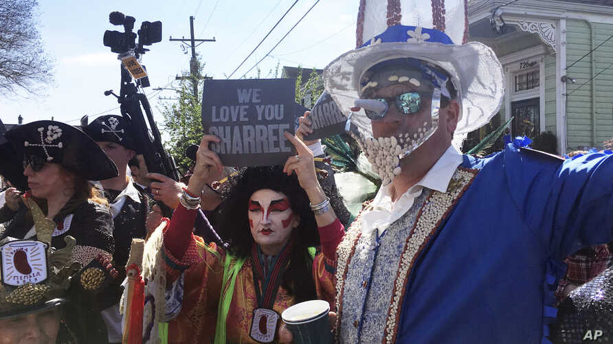 Costumed revelers gather Monday, March 4, 2019, for the annual Krewe of Red Beans march in New Orleans.