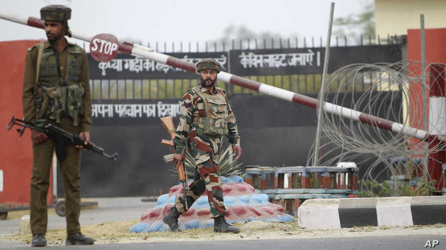 Indian soldiers take are seen outside an army camp at Nagrota, in the outskirts of Jammu, India, Nov. 29, 2016.