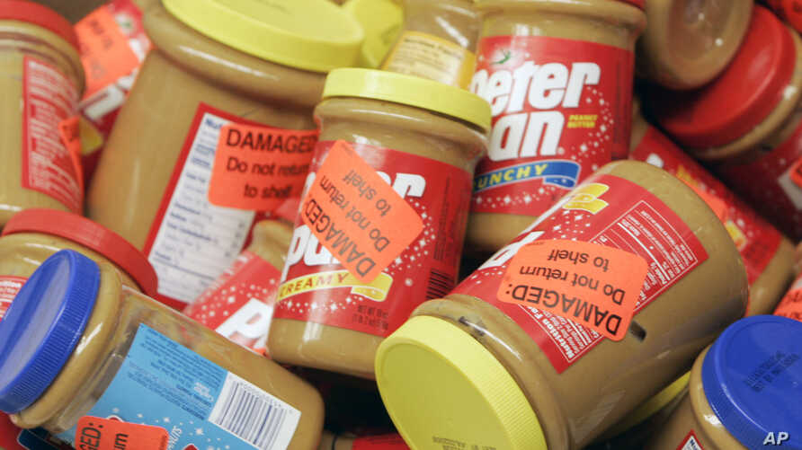 FILE - Returned jars of Peter Pan Peanut Butter are piled up at a supermarket in Atlanta, Georgia, Feb. 16, 2007.